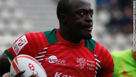 Kenya's Collins Injera runs with the ball during a HSBC Paris Sevens Series rugby match between Kenya and Portugal at the Stade Jean Bouin in Paris on May 13, 2016. / AFP / THOMAS SAMSON        (Photo credit should read THOMAS SAMSON/AFP/Getty Images)