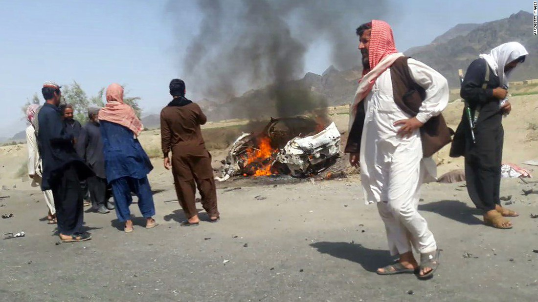 "Residents gather around a destroyed car reportedly hit by a drone strike near the town of Ahmad Wal, Pakistan, on Saturday, May 21. Afghan Taliban leader Mullah Akhtar Mohammad Mansour was believed to be traveling in the vehicle. Sources within al Qaeda and the Taliban, reached through an intermediary by CNN, <a href=""http://www.cnn.com/2016/05/21/politics/u-s-conducted-airstrike-against-taliban-leader-mullah-mansour/index.html"">confirmed Mansour's death</a> on Sunday, May 22."