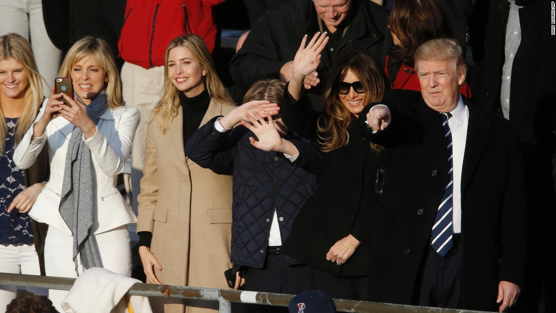 Republican presidential candidate Donald Trump, accompanied by his wife, Melania, second right, and former wife Marla Maples, second left, watches his daughter Tiffany graduate from the University of Pennsylvania on Sunday, May 15.