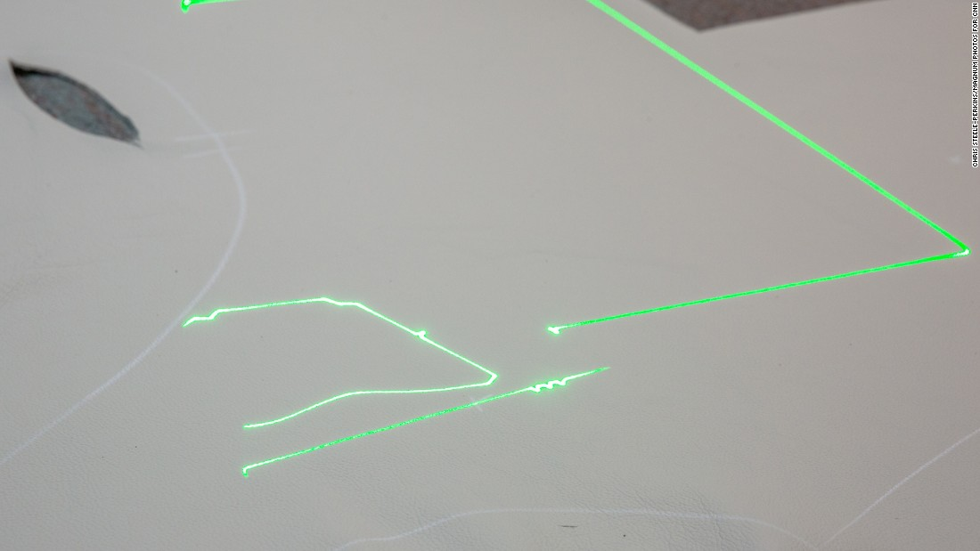 Computerized lasers are used to precisely cut each leather piece.