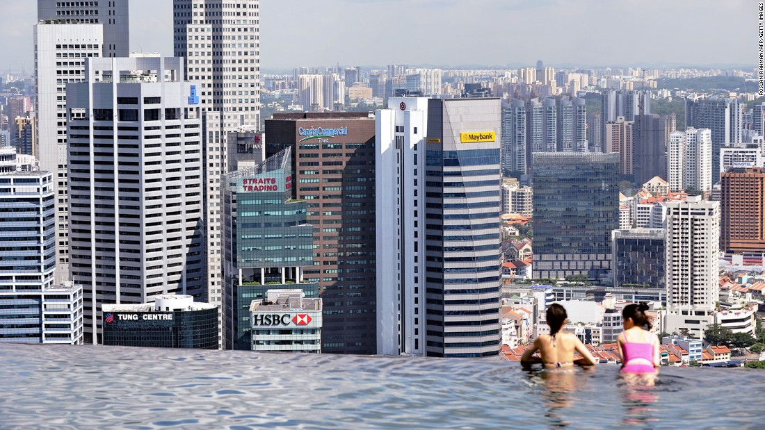 The city's skyline is visible from the pool.