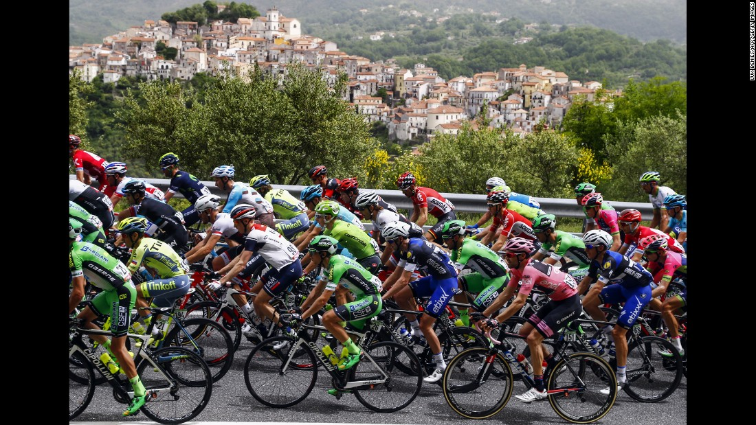 The pack rides past Rivello village during the 5th stage of 99th Giro d'Italia, Tour of Italy, from Praia a Mare to Benevento of 233 km on May 11, in Benevento.