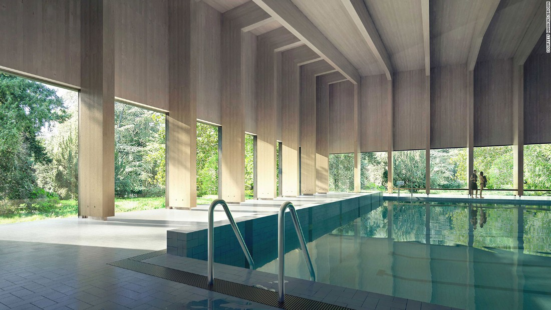 This swimming pool by Hawkins/Brown features a roof made out of timber.