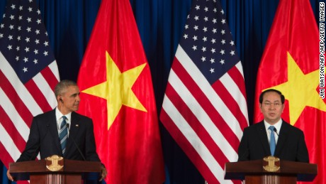 "US President Barack Obama and Vietnamese President Tran Dai Quang speak during a joint press conference in Hanoi on May 23, 2016. Barack Obama praised ""strengthening ties"" between the United States and Vietnam at the start of a landmark visit May 23, as the former wartime foes deepen trade links and share concerns over Chinese actions in disputed seas. / AFP / JIM WATSON        (Photo credit should read JIM WATSON/AFP/Getty Images)"
