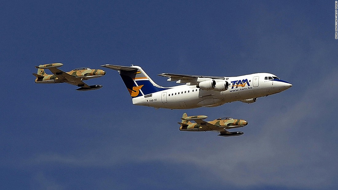 Pictured in 2009, a BAe 146-200, given by President Evo Morales to the Bolivian Air Force, flies over a military airport in La Paz, escorted by military aircraft.