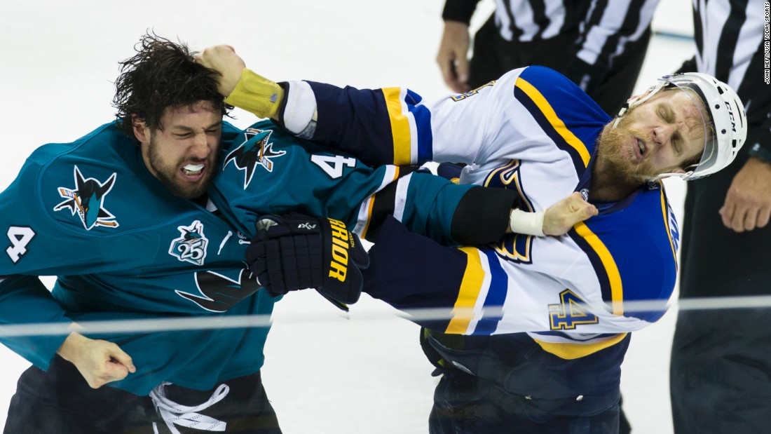 San Jose's Brenden Dillon, left, scraps with St. Louis' Carl Gunnarsson during Game 4 of the NHL's Western Conference Final on Saturday, May 21.