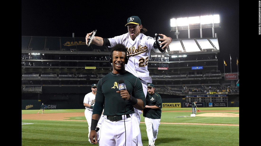 Oakland's Josh Reddick prepares to smash two pies into the face of teammate Khris Davis as Davis gives a television interview on Tuesday, May 17. Davis had just hit a walk-off grand slam to beat Texas 8-5.