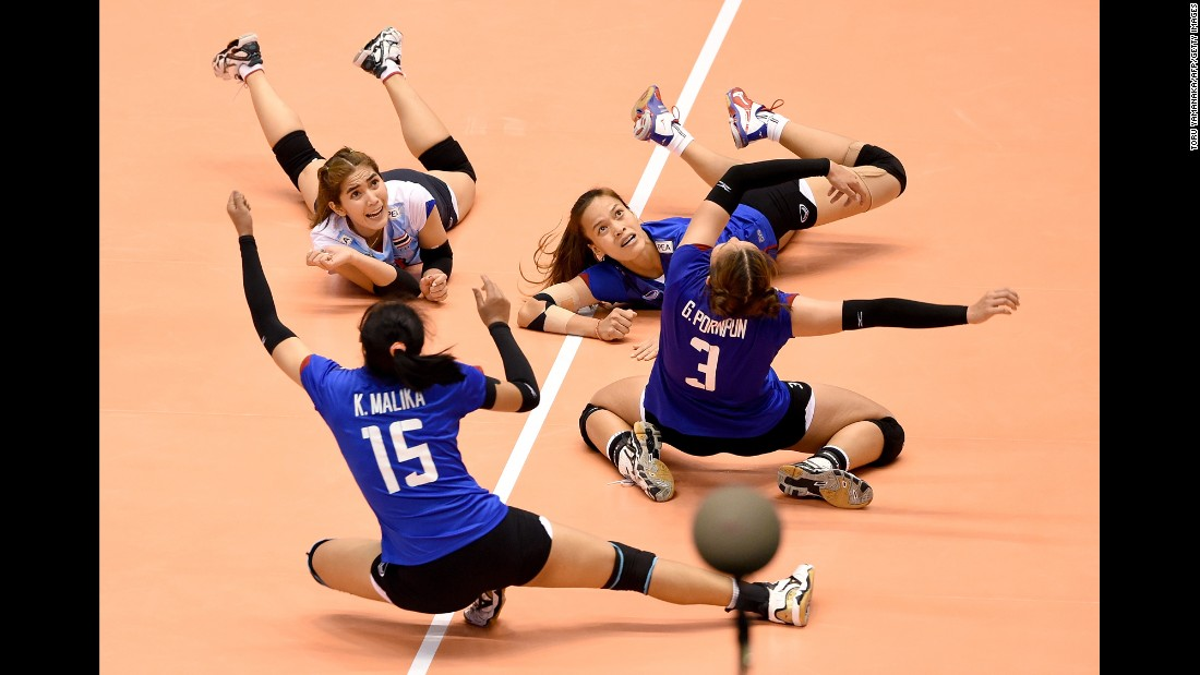 Thai volleyball players dive on the court during an Olympic qualifying tournament on Saturday, May 21. Thailand defeated South Korea, but it was South Korea that would eventually advance to Rio de Janeiro.