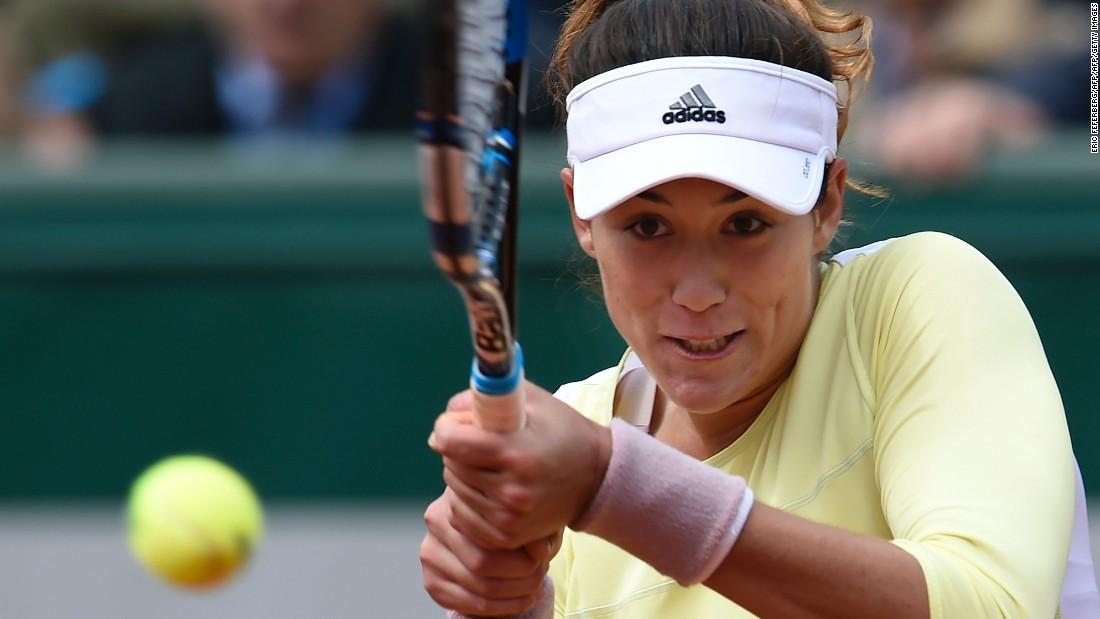 Garbine Muguruza, the 2015 Wimbledon finalist, rallied to defeat Anna Karolina Schmiedlova 3-6 6-3 6-3.