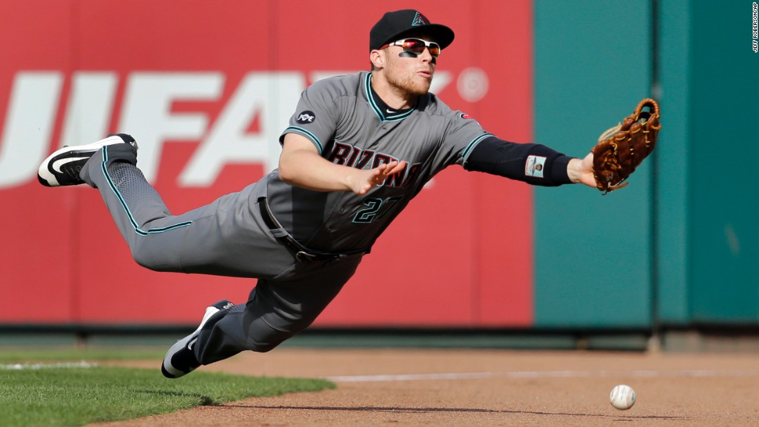 Arizona right fielder Brandon Drury is unable to make the catch after diving for a foul ball in St. Louis on Saturday, May 21.