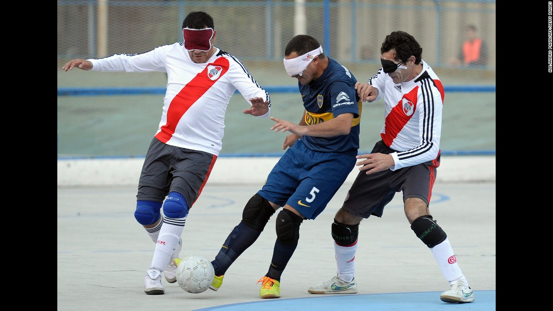 Boca Juniors' Silvio Velo, center, competes against River Plate's Daniel Vega, left, and Oscar Mouzo during a blind-soccer match in Buenos Aires on Saturday, May 21. In blind soccer, the teams are made up of four visually impaired outfield players wearing blindfolds. The goalkeeper does not wear a blindfold, and he or she may be fully sighted. The ball is designed to make a sound when it moves.