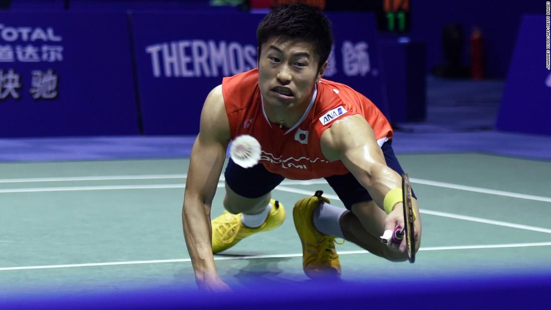 Japan's Sho Sasaki dives for a shot Wednesday, May 18, during a Thomas Cup badminton match in Kunshan, China.