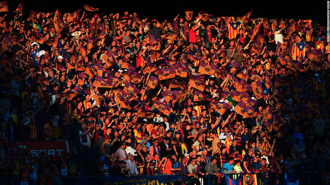 Barcelona fans wave flags before the Copa del Rey (King's Cup) final in Madrid on Sunday, May 22. The Spanish league champions defeated Sevilla 2-0 to complete the domestic double.