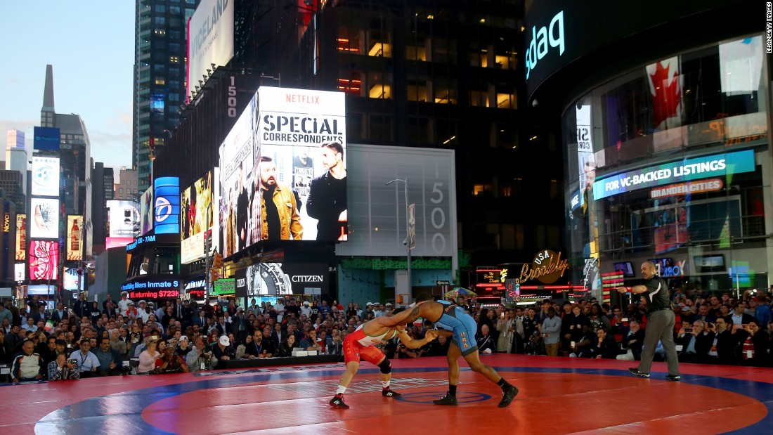 Iran's Peyman Yarahmadi, left, takes on American Jordan Burroughs during a wrestling event in New York's Times Square on Thursday, May 19.