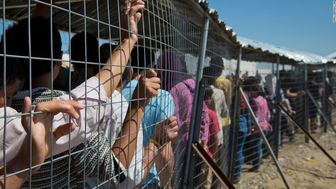 Migrants wait for the distribution of aid at the Idomeni camp on May 23.