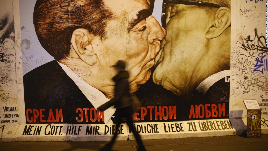 "The mural is a play on a famous work of art on the Berlin wall depicting Soviet leader Leonid Brezhnev and East German leader Erich Honecker sharing a kiss. The message below reads: ""My God, help me survive this deadly love."""
