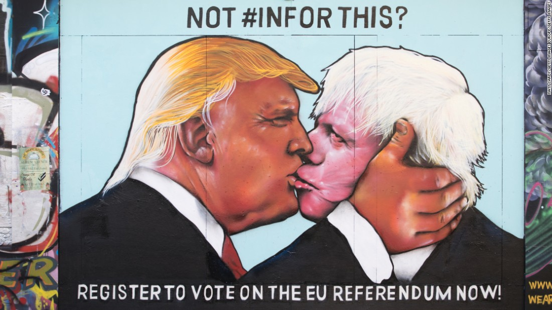 A mural painted on a derelict building in Stokes Croft shows US presidential hopeful Donald Trump sharing a kiss with former London Mayor Boris Johnson, on May 24, 2016 in Bristol, England.