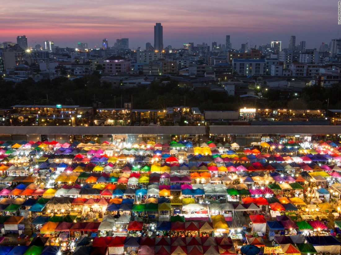 "A rainbow of a different kind is created by the back-lit canopies of this colorful night market in Bangkok, taken by Kajan Madrasmail. (<a href=""http://travel.nationalgeographic.com/photographer-of-the-year-2016/"" target=""_blank"">Click here to enter NatGeo photo contest</a>)"
