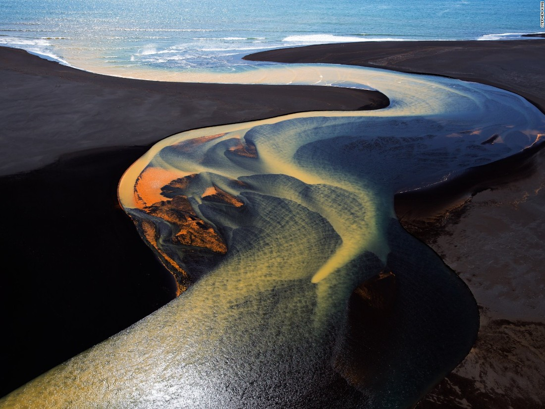 "Stephen King submitted this aerial shot from a helicopter over southern Iceland. ""The brilliant colors are a result of mineral deposits picked up by the glacial waters as they flow toward the sea,"" he says. (<a href=""http://travel.nationalgeographic.com/photographer-of-the-year-2016/"" target=""_blank"">Click here to enter NatGeo photo contest</a>)"