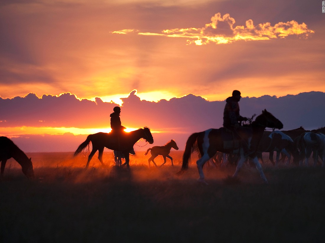 "Kazakh horsemen drive their herd to a corral where they'll spend the night being guarded against horse thieves. Ryan Bell says he took this image about 100 miles from the site in Kazakhstan where archeologists have discovered the oldest-known remains of a domesticated horse. (<a href=""http://travel.nationalgeographic.com/photographer-of-the-year-2016/"" target=""_blank"">Click here to enter NatGeo photo contest</a>)"