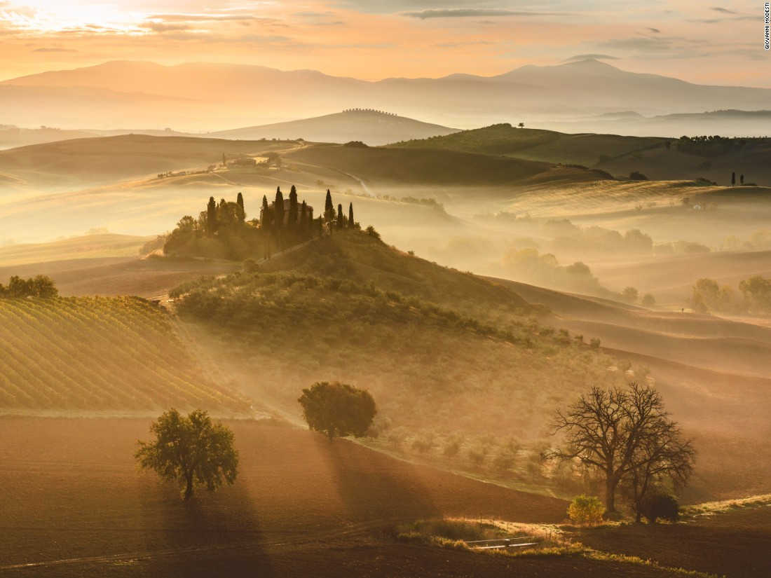 "Beautiful at any time of day, the Italian region of Tuscany looks even more wonderful in this sunrise image taken by Giovanni Modesti. (<a href=""http://travel.nationalgeographic.com/photographer-of-the-year-2016/"" target=""_blank"">Click here to enter NatGeo photo contest</a>)"