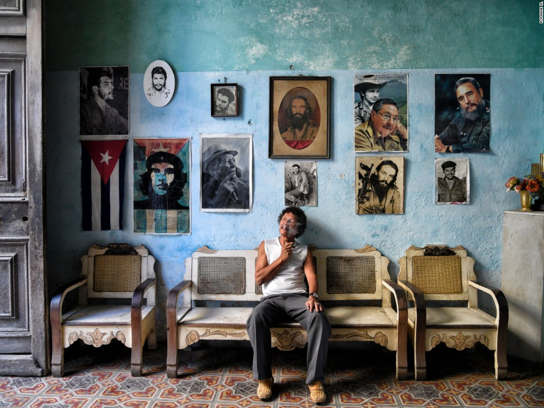 "Romaine W says he was drawn to this museum-like house in Havana. ""As Cubans are always welcoming to guests I decided to take a peek inside, only to find out that this was actually a home containing collectible items from vinyl records to a large scale American flag, then to this wall of icons; decorated with a Cuban flag, revolutionary fighters and past and present Cuban leaders."" (<a href=""http://travel.nationalgeographic.com/photographer-of-the-year-2016/"" target=""_blank"">Click here to enter NatGeo photo contest</a>)"