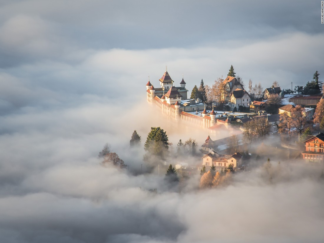 "Boukhechina Malik climbed above low clouds to shoot this image in Sonchaux, Switzerland. ""I thought I was immersed in a fairytale, out of every human scale."" (<a href=""http://travel.nationalgeographic.com/photographer-of-the-year-2016/"" target=""_blank"">Click here to enter NatGeo photo contest</a>)"