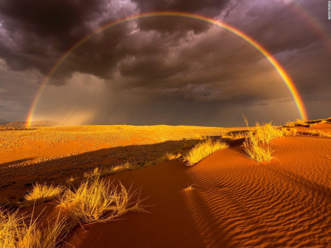 "National Geographic's 2016 travel photography awards have drawn some amazing entries. These include this image of a rare thunderstorm and rainbow over Namibia's Namibrand-Park by Stefan Forster. Click through the gallery to see more entries. (<a href=""http://travel.nationalgeographic.com/photographer-of-the-year-2016/"" target=""_blank"">Click here to enter NatGeo photo contest</a>)"