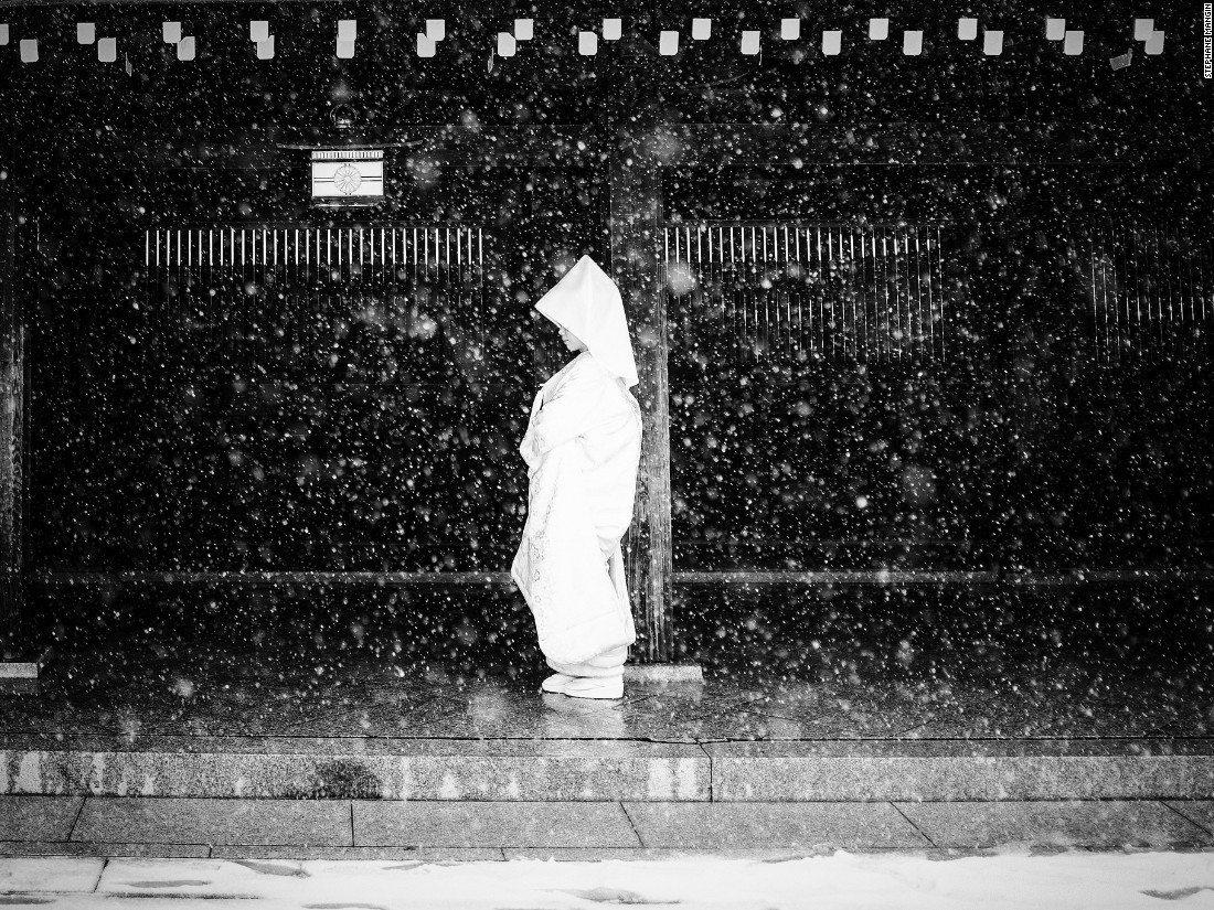 "Stephane Mangin describes this woman on her wedding day in Japan as a ""brave bride,"" for enduring snowy conditions on the only day of snow in Tokyo's 2014 winter. (<a href=""http://travel.nationalgeographic.com/photographer-of-the-year-2016/"" target=""_blank"">Click here to enter NatGeo photo contest</a>)"