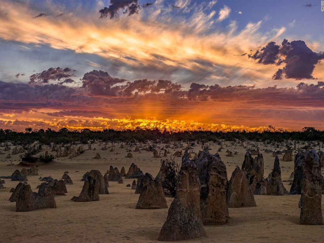 "Sam Yick captures a moment of fiery light over the stark landscape of the Pinnacles rock formations in Western Australia. (<a href=""http://travel.nationalgeographic.com/photographer-of-the-year-2016/"" target=""_blank"">Click here to enter NatGeo photo contest</a>)"