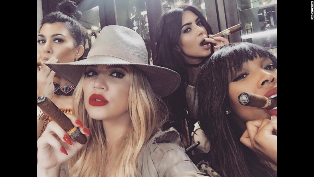 "Television personality Khloe Kardashian, second from left, <a href=""https://www.instagram.com/p/BFAKLFGBRgY/"" target=""_blank"">smokes a cigar</a> during a trip to Cuba on Wednesday, May 4. Joining her, from left, are sisters Kourtney and Kim and friend Malika Haqq."