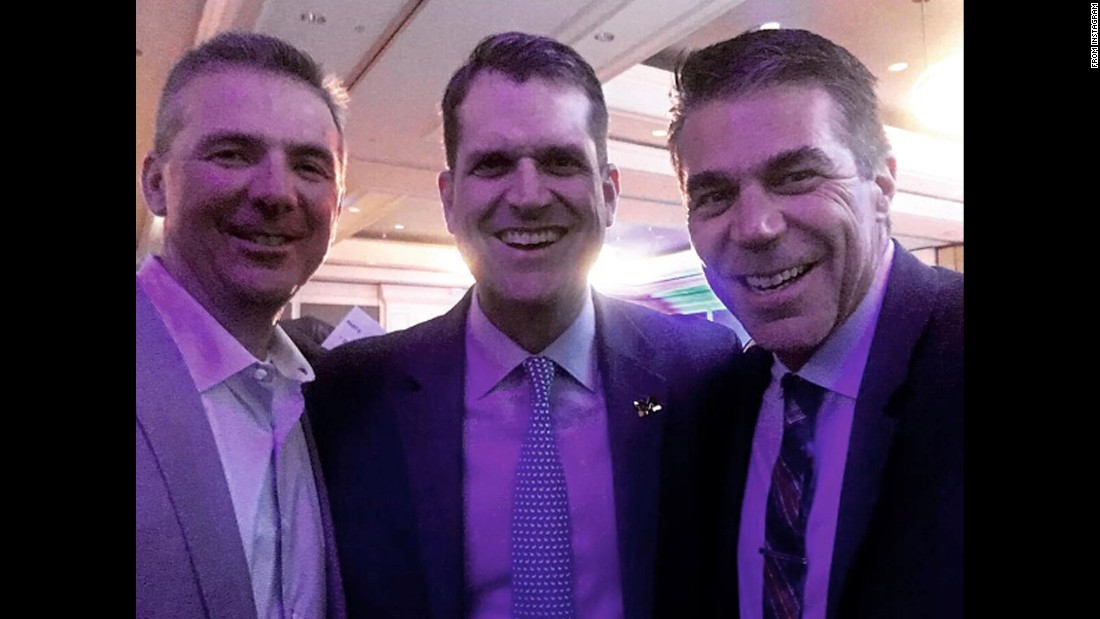 "ESPN's Chris Fowler, right, managed to bring together two of college football's fiercest rivals on Friday, May 13: Ohio State head coach Urban Meyer, left, and Michigan head coach Jim Harbaugh. ""Anyone else have a selfie with smiling Harbaugh and Meyer?! Only at the @dickiev amazing event for pediatric cancer research!"" <a href=""https://www.instagram.com/p/BFXrk1CCsPd/"" target=""_blank"">Fowler said on Instagram.</a>"