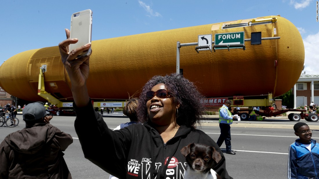 "A woman takes a selfie as a massive fuel tank, which was built for NASA's space shuttle program, <a href=""http://www.cnn.com/videos/us/2016/05/23/shuttle-fuel-tank-los-angeles-nccorig.cnn"" target=""_blank"">makes its way to a science center in Los Angeles</a> on Saturday, May 21."