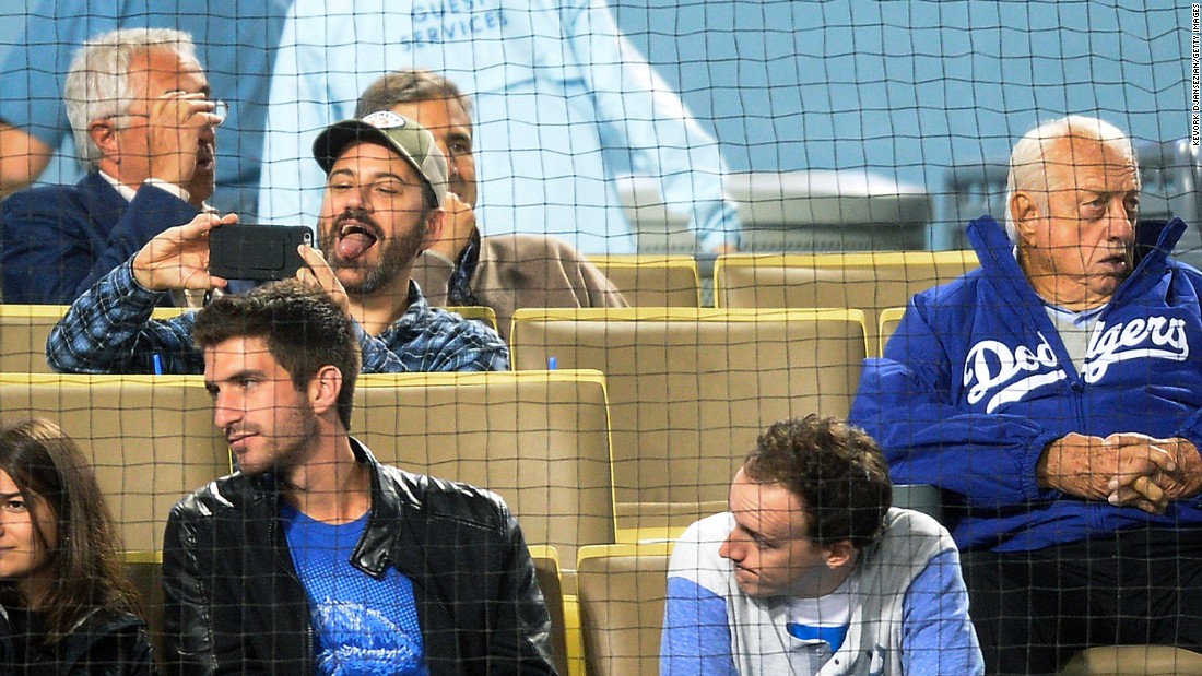 Late-night talk show host Jimmy Kimmel makes a face as he takes a selfie at a Los Angeles Dodgers baseball game on Tuesday, May 10. On the far right is former Dodgers manager Tommy Lasorda.