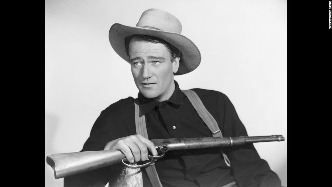 "John Wayne holds a rifle in this publicity photo taken for the 1941 movie ""The Shepherd of the Hills."" The iconic actor, who starred in many popular Westerns and won an Academy Award for his role in ""True Grit,"" was born on this day in 1907."