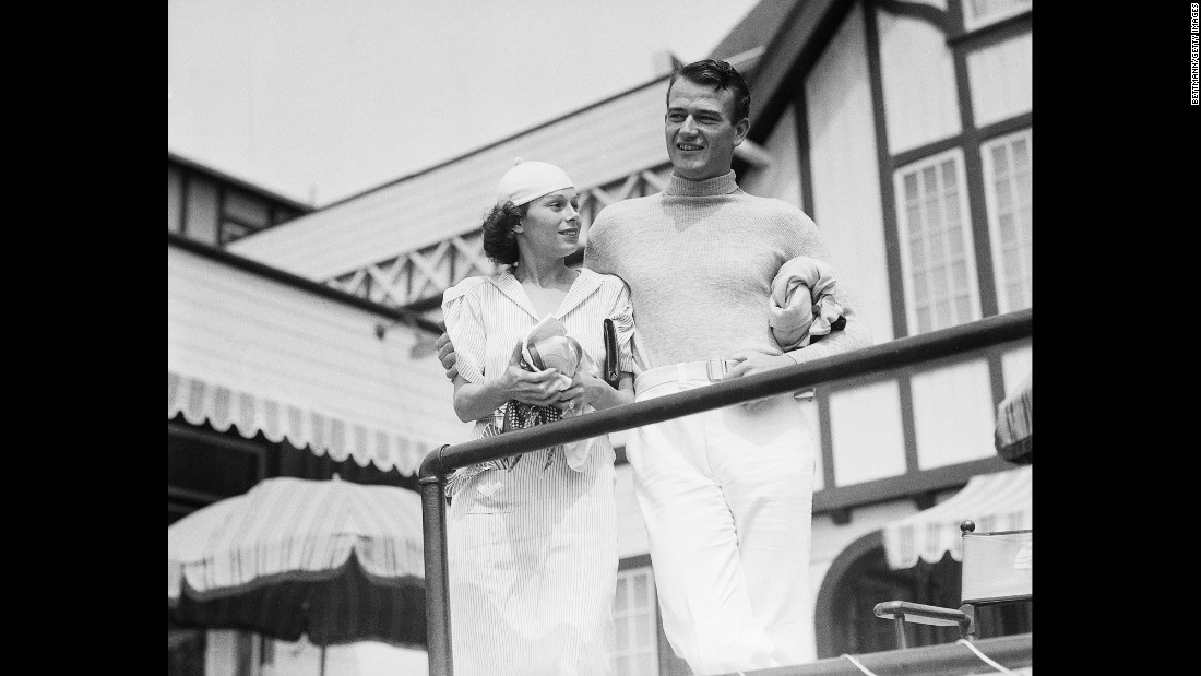 Wayne spends time with his new wife, Josephine, at an exclusive swimming club in Santa Monica, California, in 1933.