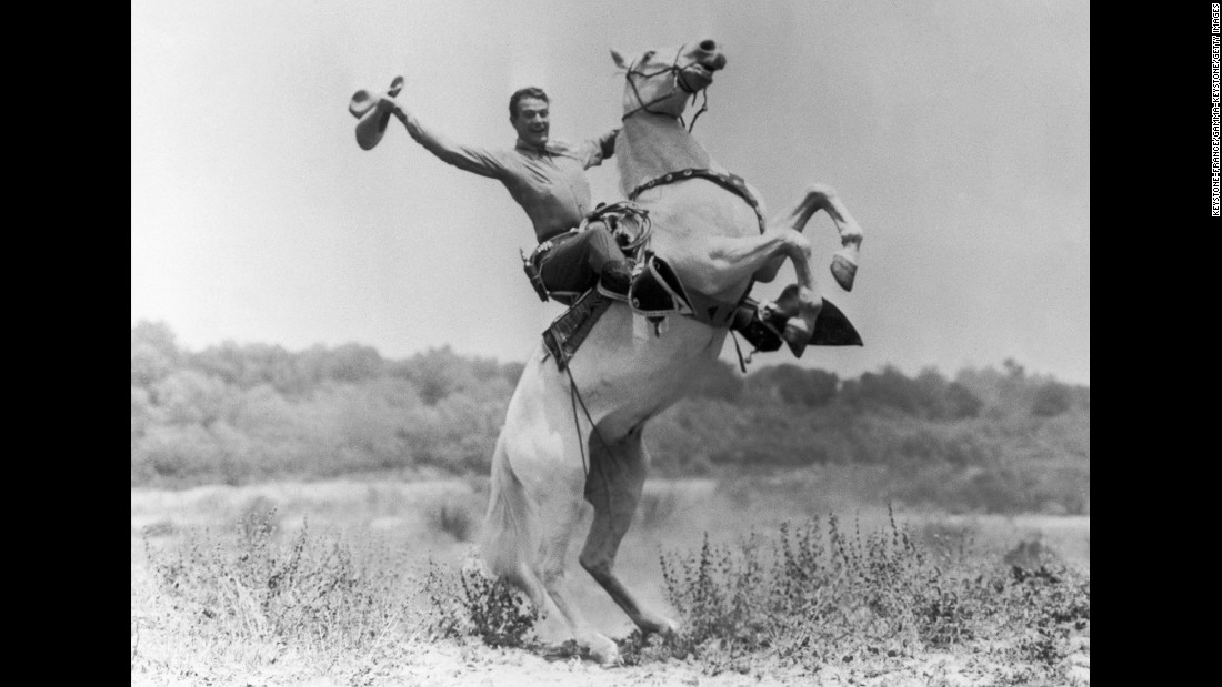 Wayne rides a horse in 1935.