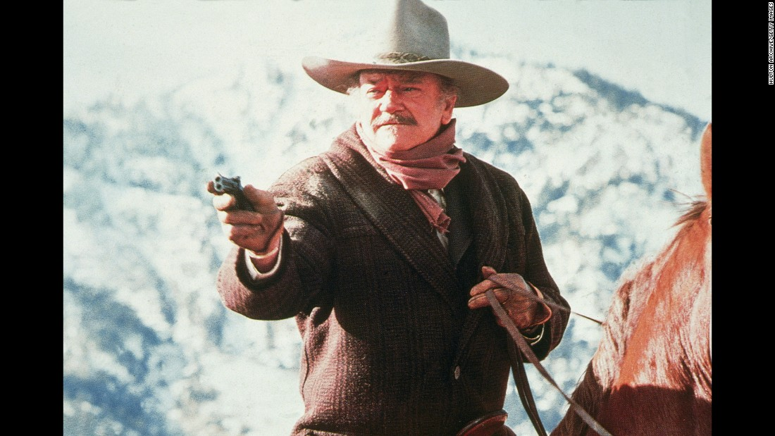 "Wayne aims a gun during a scene from ""The Shootist"" in 1976. It was his last film. He was 72 years old when he died from stomach cancer in 1979. ""In terms of longevity and popular appeal, both in the United States and elsewhere, there simply never was an actor like him,"" Kistler wrote then in the Los Angeles Times."