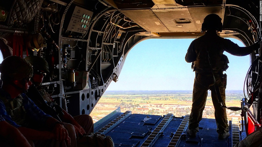 Military members keep constant watch aboard a plane in Iraq.