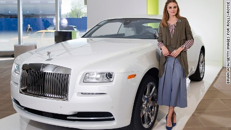 Don't forget the car! That custom luggage fits perfectly in the trunk of the Rolls-Royce Wraith, appreciated here by New York socialite Olivia Palermo.