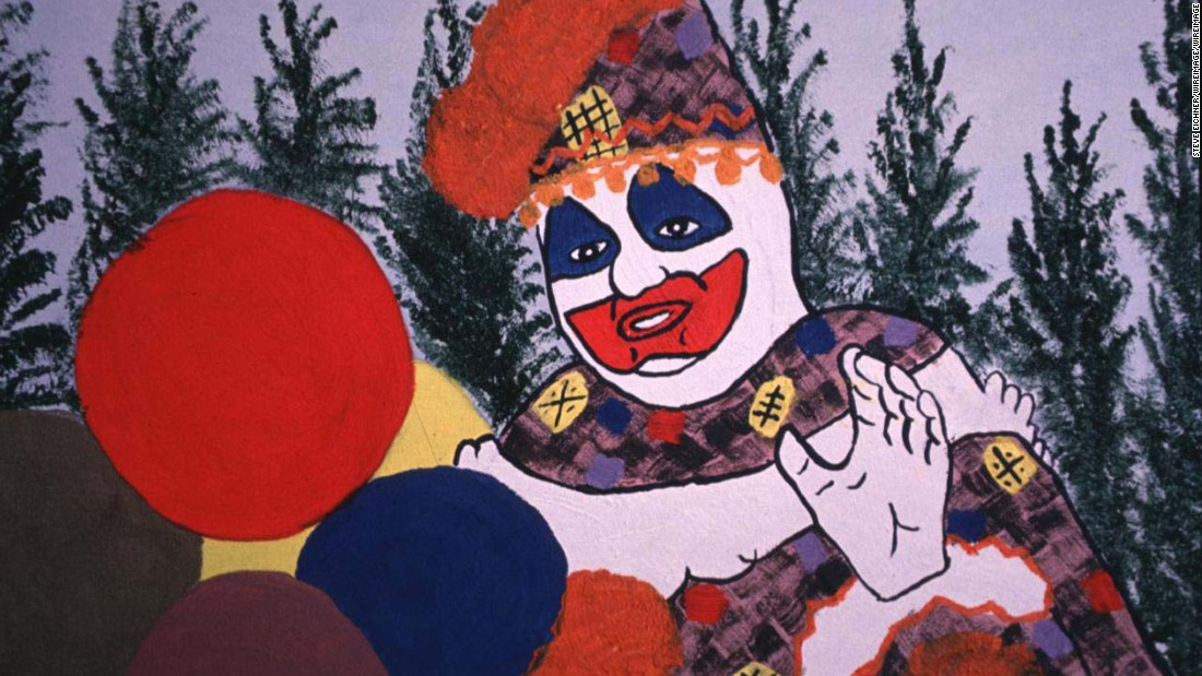 "Known as the ""Killer Clown"", Gacy was an American serial killer who murdered 33 boys and young men in the 1970s. Gacy was also a clown, performing at childrens' parties as ""Patches"" or ""Pogo"" -- the characters he would go on to draw whilst imprisoned. Gacy was executed by lethal injection in 1994."