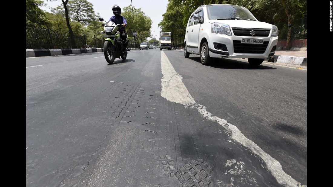 A road in New Delhi melts as the temperature reaches 43 degrees Celsius (109 degrees Fahrenheit) on Thursday, May 19. Much of India is reeling from a heat wave and severe drought conditions that have decimated crops, killed livestock and left at least 330 million people without enough water for their daily needs.