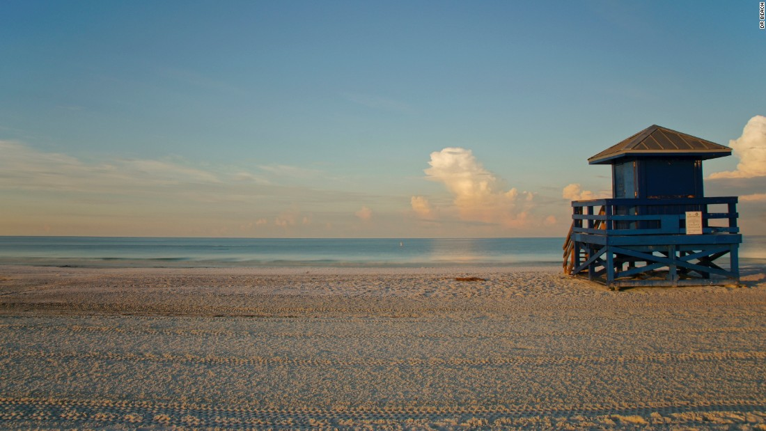 Siesta Beach in Sarasota, Florida, has some of finest white sand and calmest, clear water in the country.