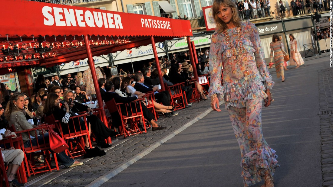Not even a volcanic ash cloud could stop Karl from staging yet another glamorous Cruise collection, this time in sunny St. Tropez. Models disembarked from boats before walking a runway at sunset in front of Sénéquier, the iconic cafe with endless rows of red director's chairs for guests to sit on.