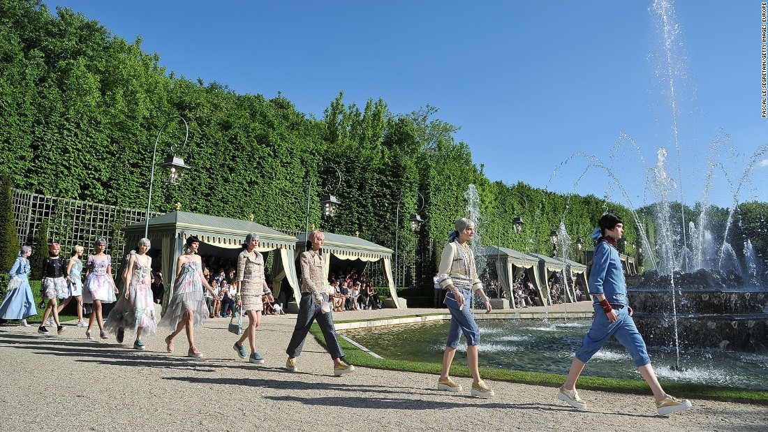 After weeks of rain, the sun shone on Lagerfeld's 2013 collection. It was staged around the fountains at Versailles, in a section never open to the public -- naturally.
