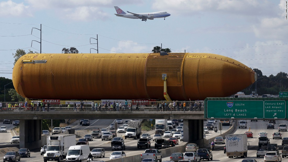 "A massive fuel tank, which was built for NASA's space shuttle program, <a href=""http://www.cnn.com/videos/us/2016/05/23/shuttle-fuel-tank-los-angeles-nccorig.cnn"" target=""_blank"">is transported to a science center in Los Angeles</a> on Saturday, May 21."