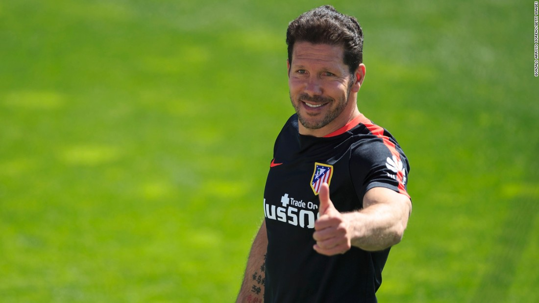 Atletico's head coach Diego Simeone gives the thumbs up during training ahead of the final. The team plays in the Argentine's image -- dogged, relentless and tenacious. Under him it broke the stranglehold of Barcelona and Real Madrid to win the Spanish League title in 2013.