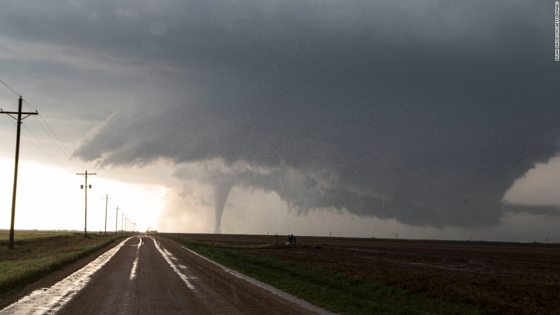 "A tornado is seen south of Dodge City, Kansas, on Tuesday, May 24. <a href=""http://www.cnn.com/2016/05/24/us/severe-weather/"" target=""_blank"">Multiple twisters</a> overturned vehicles and damaged homes this week in several Midwest states."