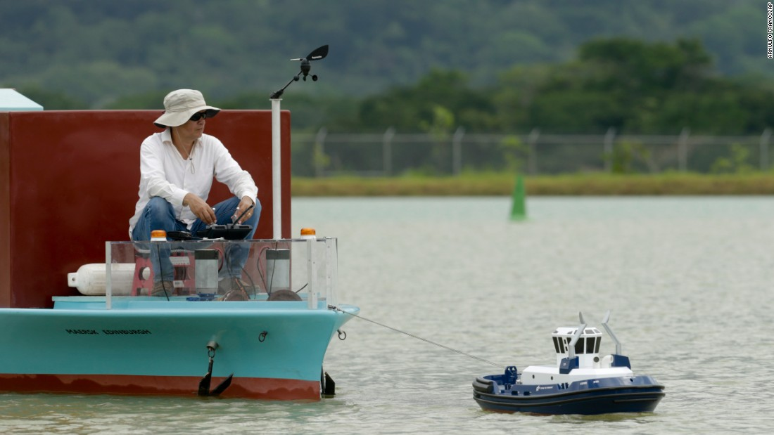 A man maneuvers a miniature tugboat at the Panama Canal training facility on Wednesday, May 25.