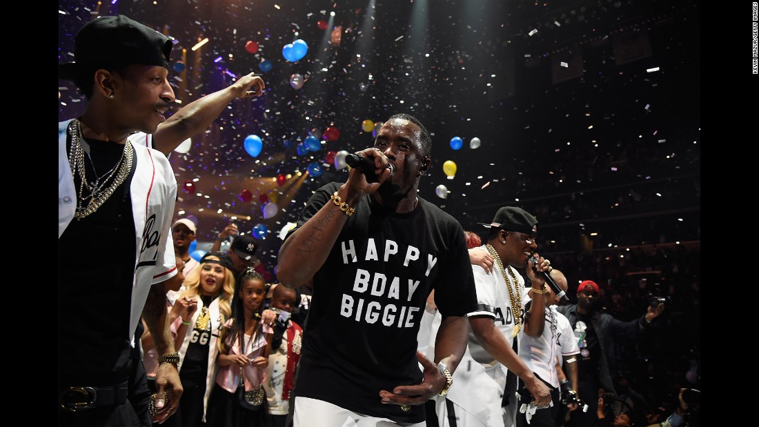 "Rapper Sean ""Diddy"" Combs performs in New York during the Bad Boy Reunion Tour on Saturday, May 21. He wore a birthday shirt honoring the Notorious B.I.G., who died in 1997."